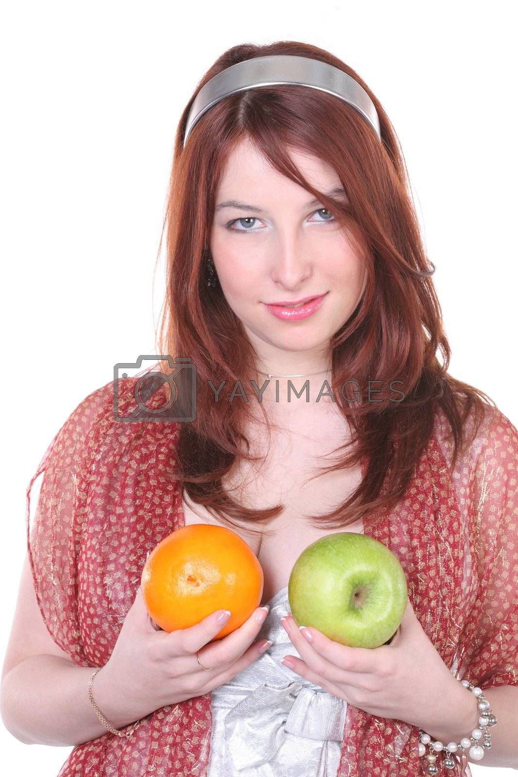 Pretty woman with green apple and orange, with copy-space