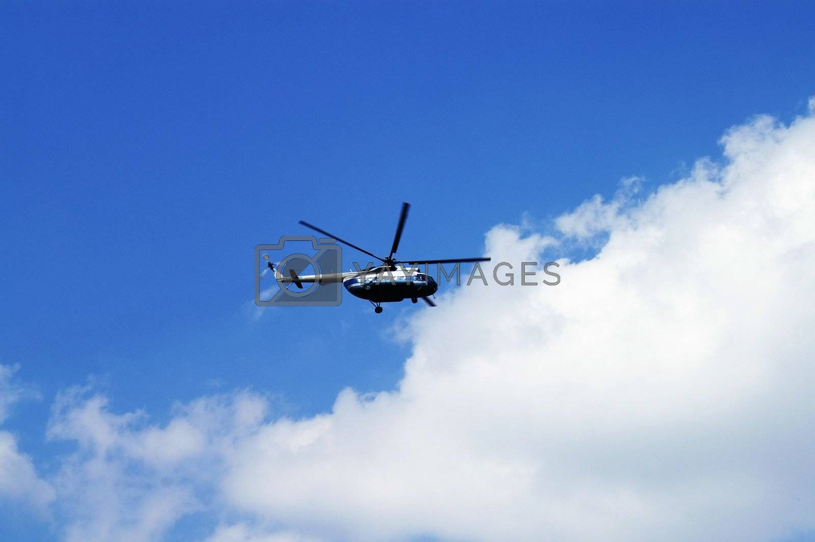 Civil Helicopter in Cloudy Skies