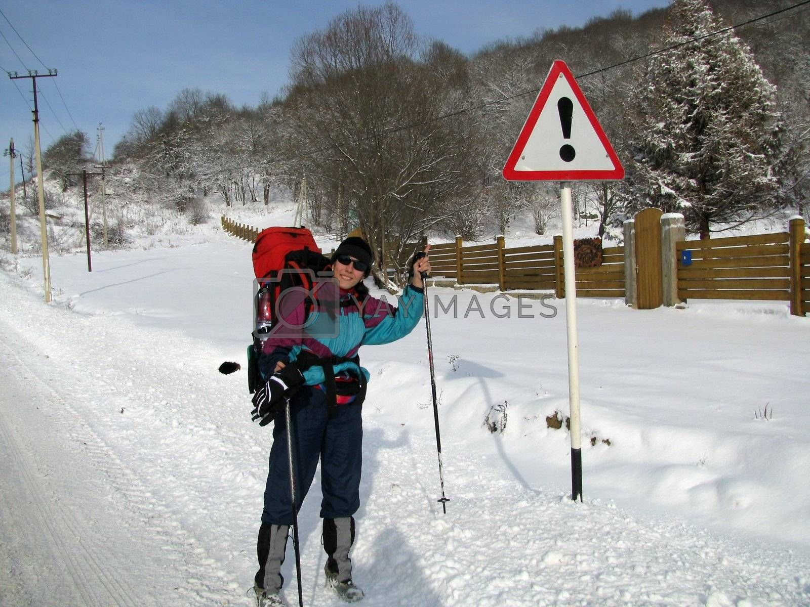 The girl, the tourist, travel, productive leisure, the nature, winter, snow, a campaign, caucasus, idea, a smile, settlement, road, wood, a kind, a sign, the index, a fence, equipment, a hill, mountains