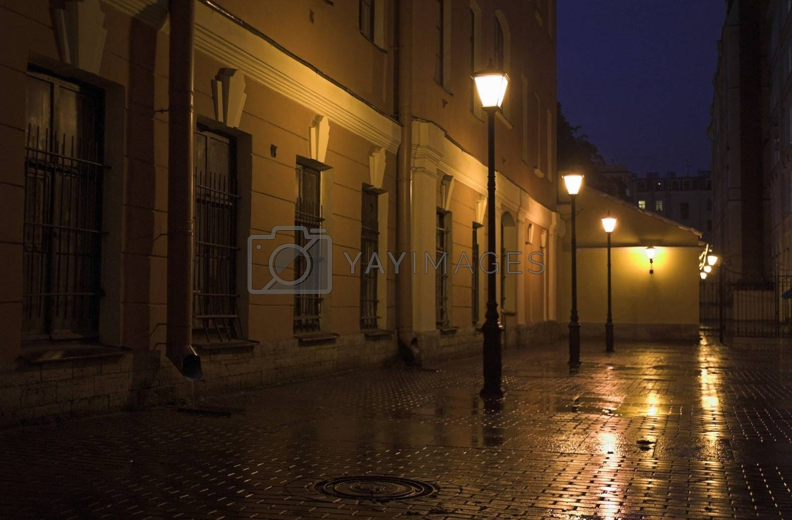 Yard with street lamps and stone pavement at evening in Saint Petersburg, Russia.