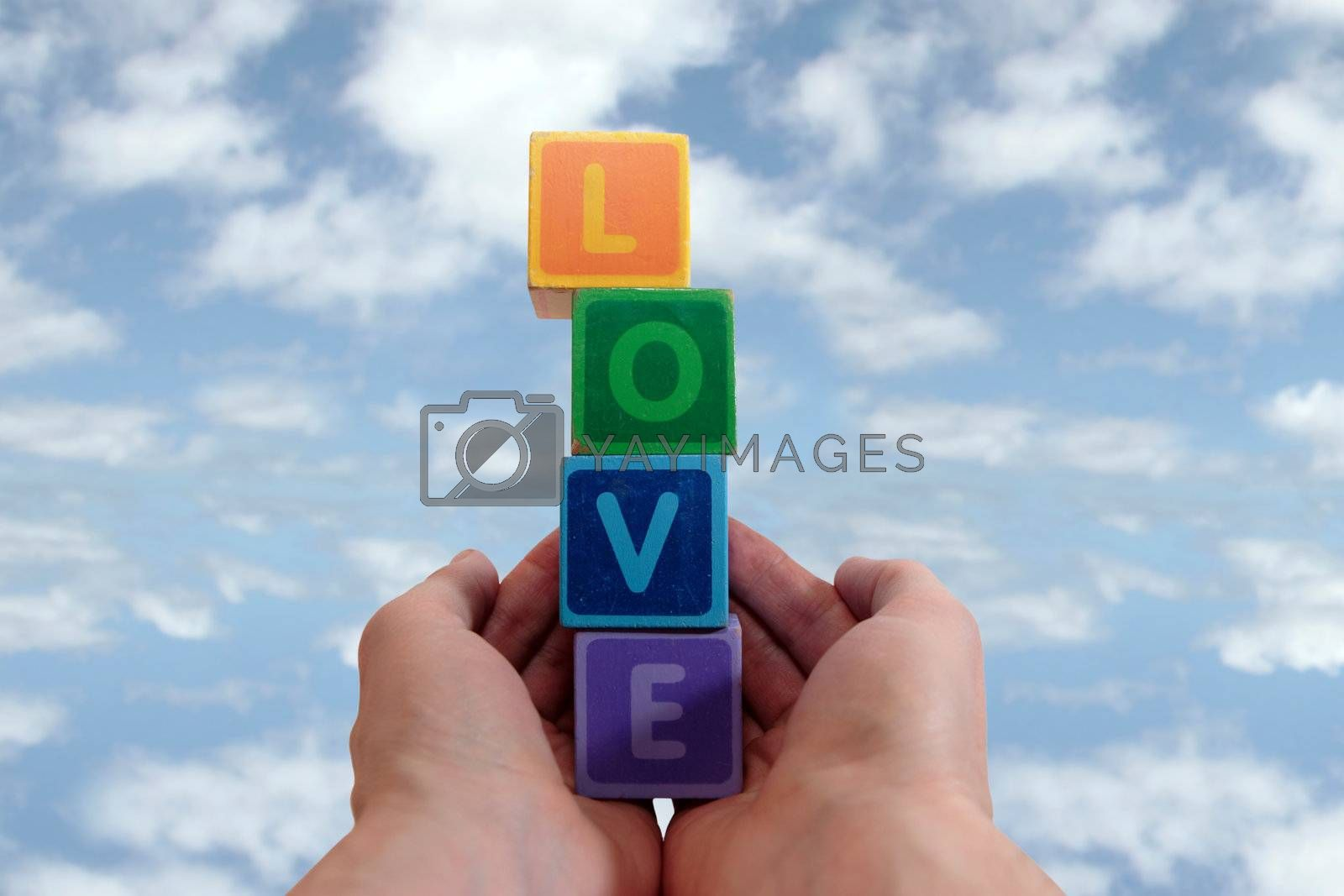 Royalty free image of outstretched hands of love by morrbyte