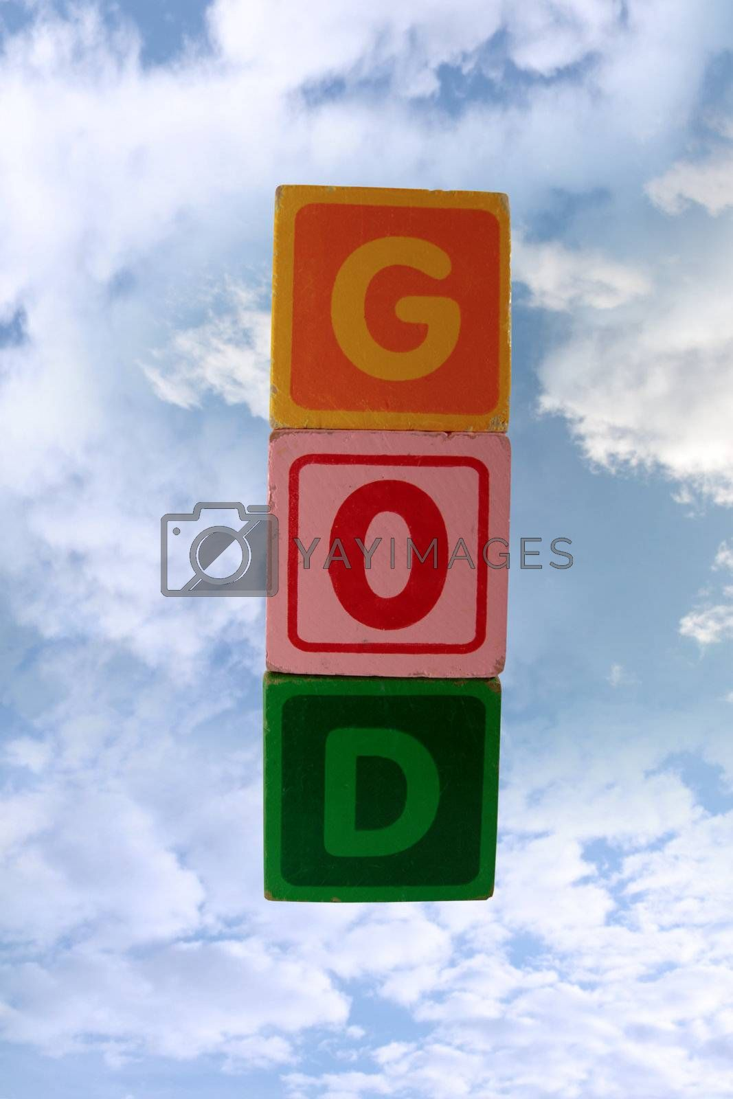 Royalty free image of play blocks that spell god in sky with clipping path by morrbyte