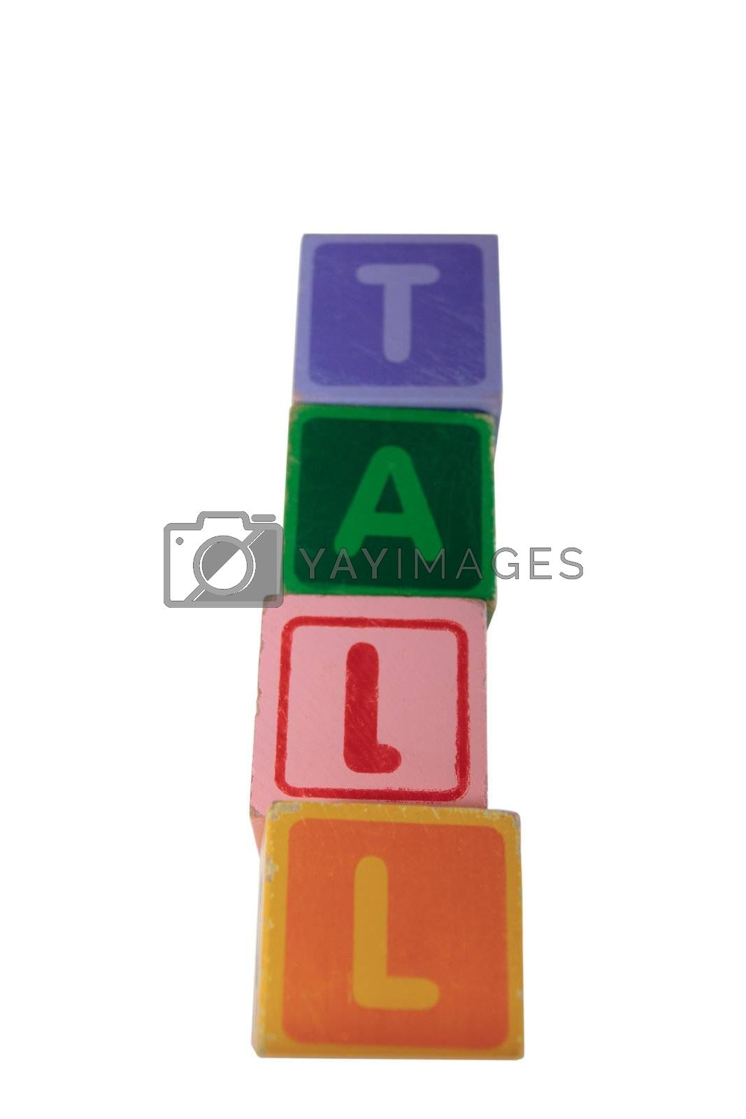 Royalty free image of tall assorted toy play blocks by morrbyte