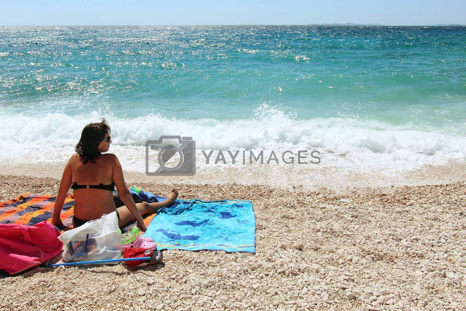 Royalty free image of Middle age woman in the beach by artush