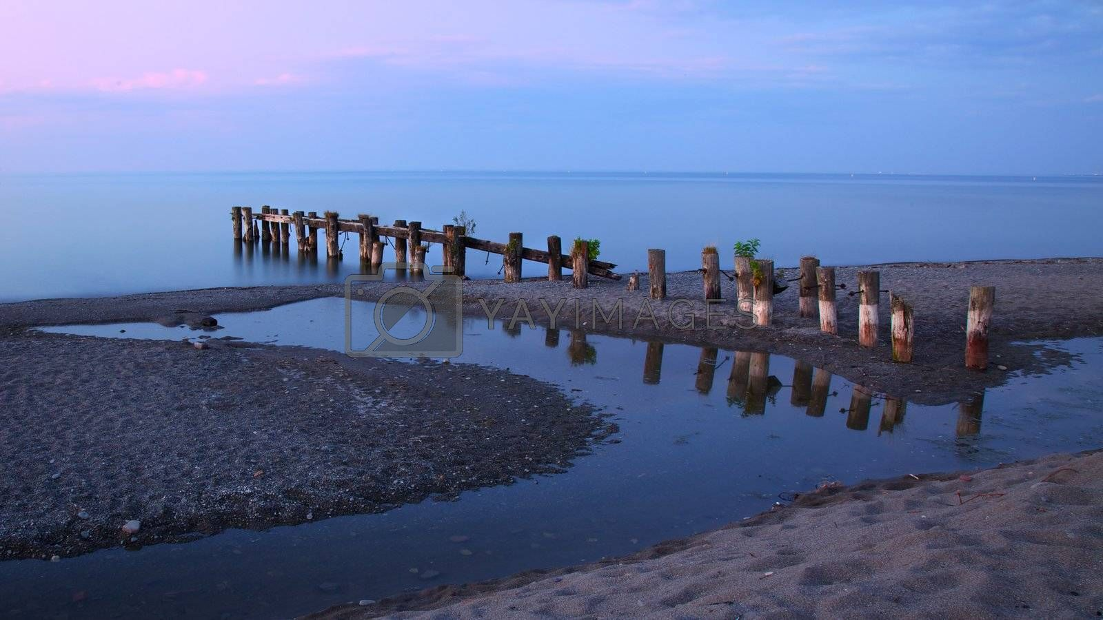 Royalty free image of Old pier on Lake Ontario by ralanscott