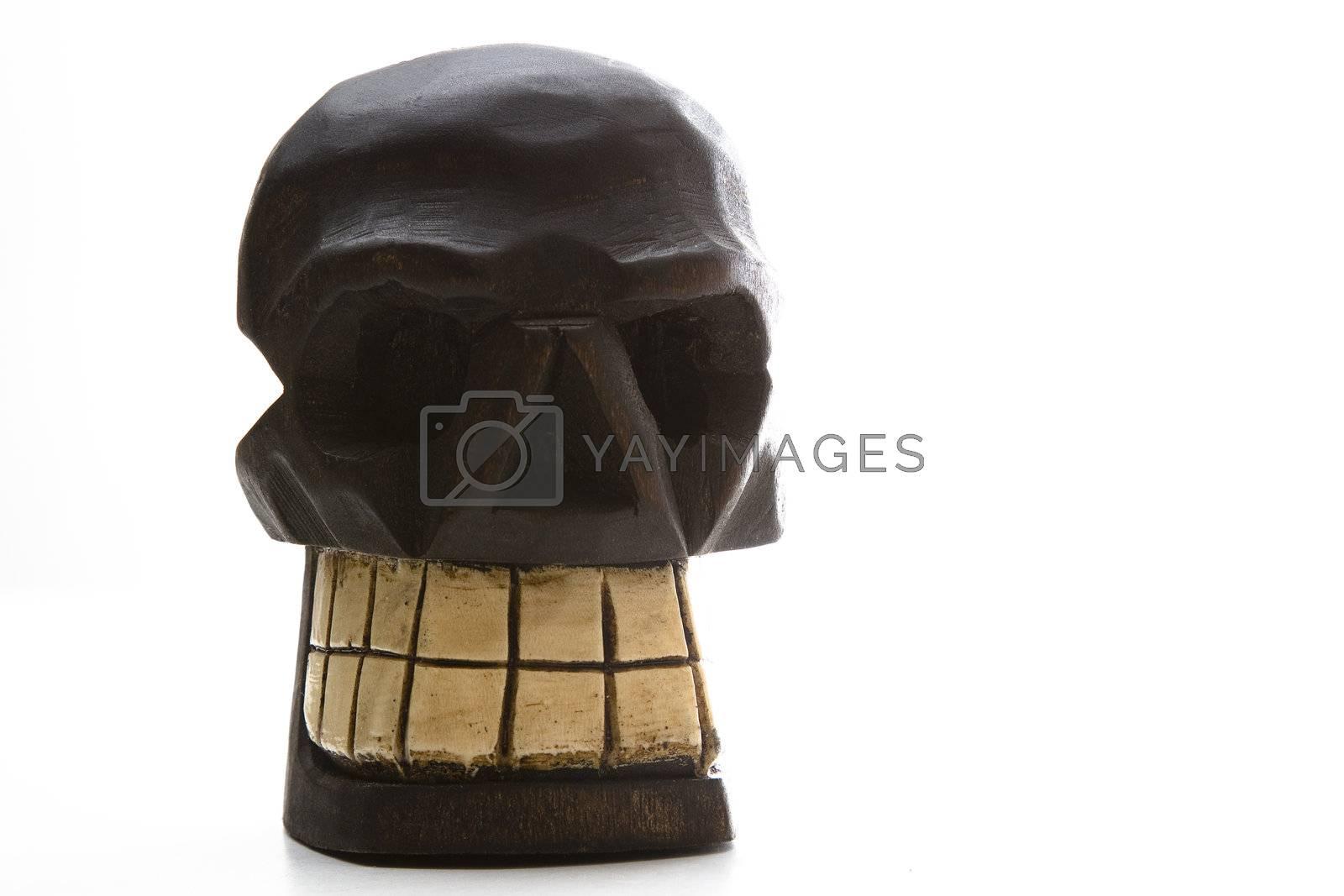 Royalty free image of Dia de los muertos wood skull by mypstudio