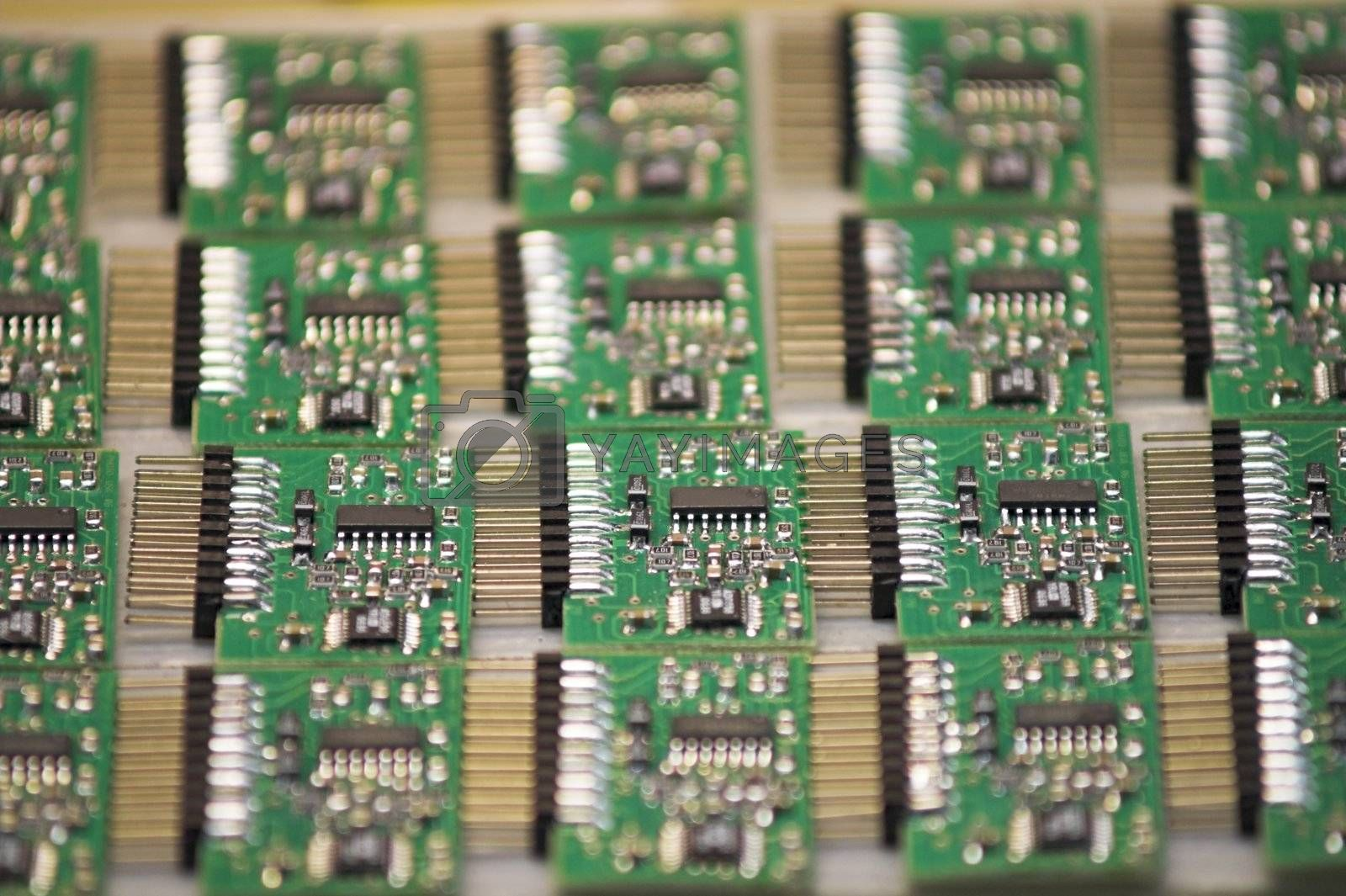 A stack of microchips lying on a table.