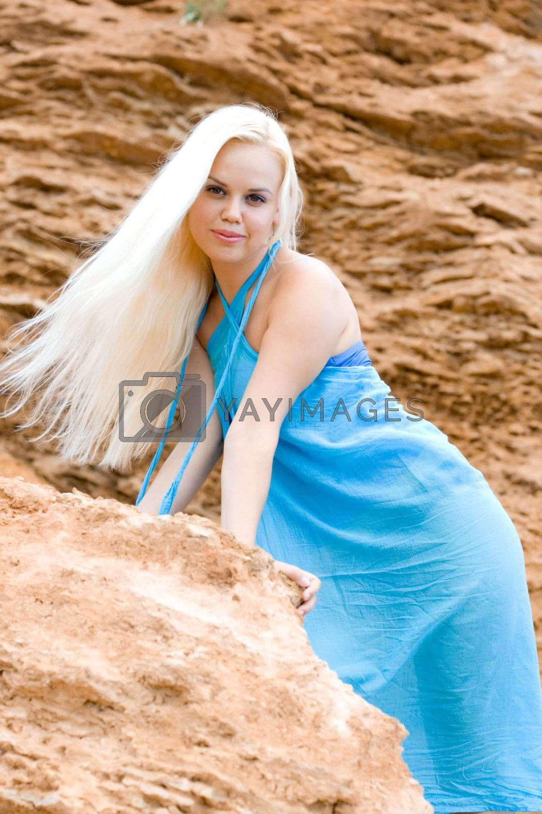 Royalty free image of blond woman among rocks by marylooo