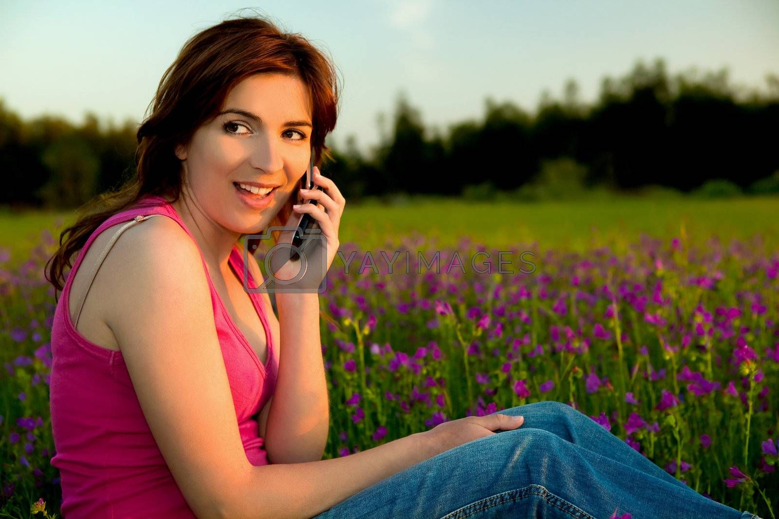 Royalty free image of Girl talking on cellphone by Iko