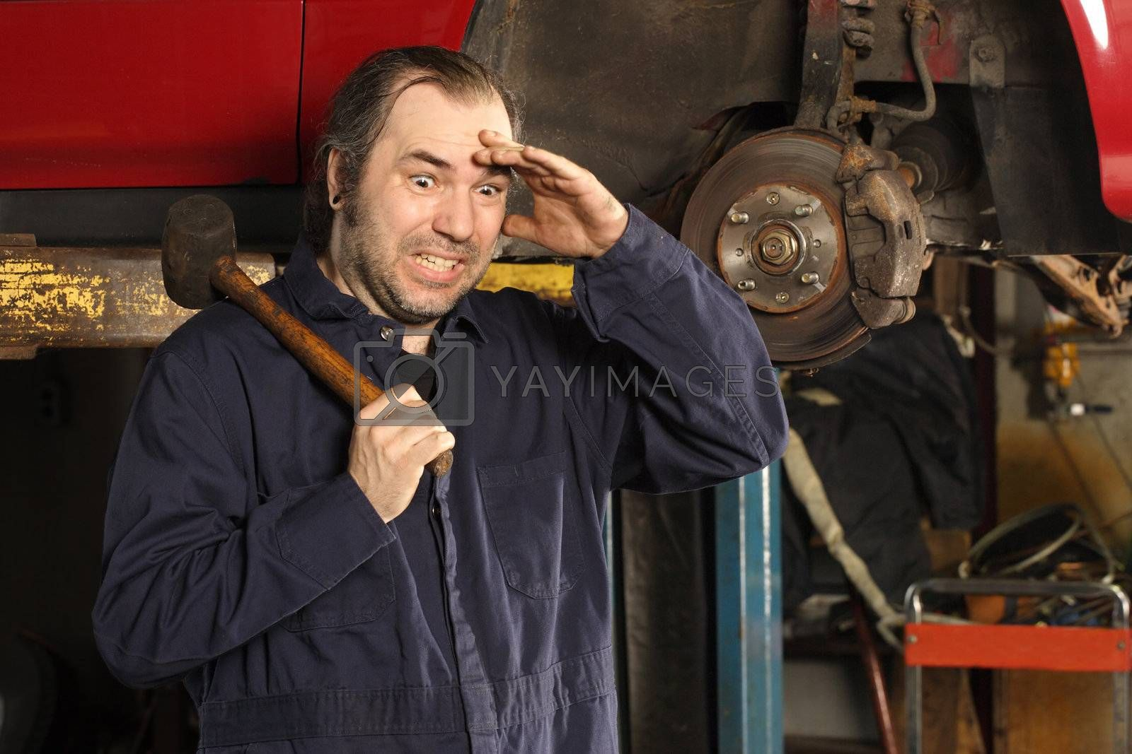 Royalty free image of Crazy mechanic confused by sumners