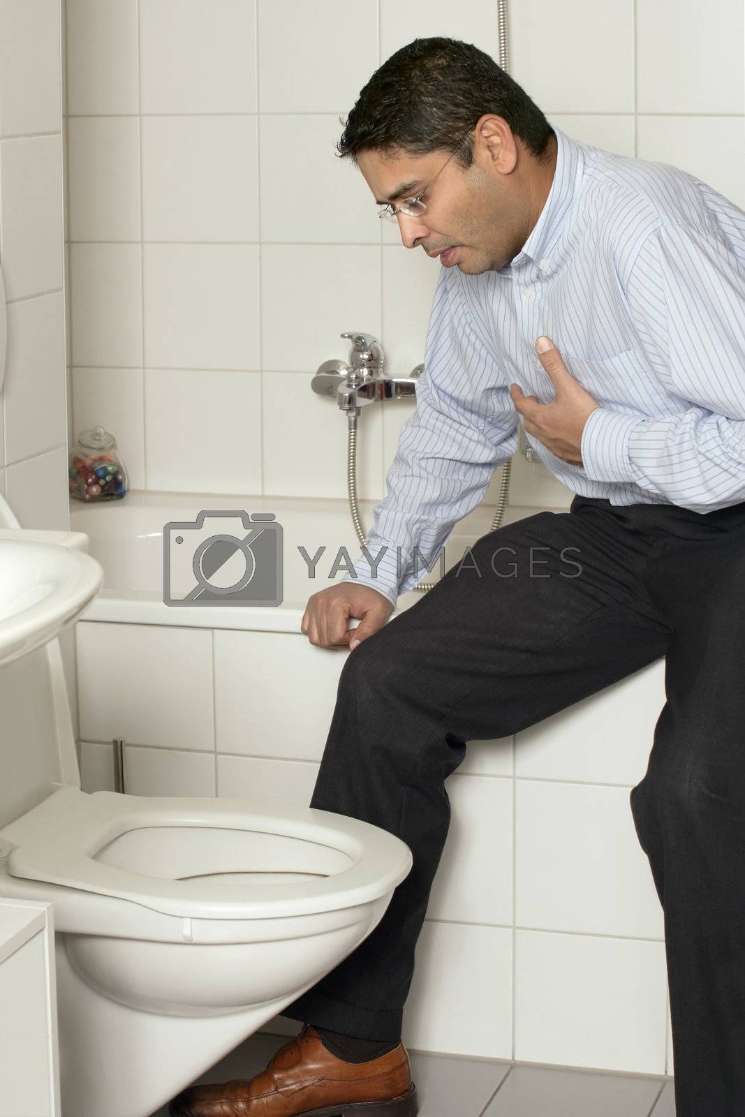 Royalty free image of Adult male with upset stomach by sumners