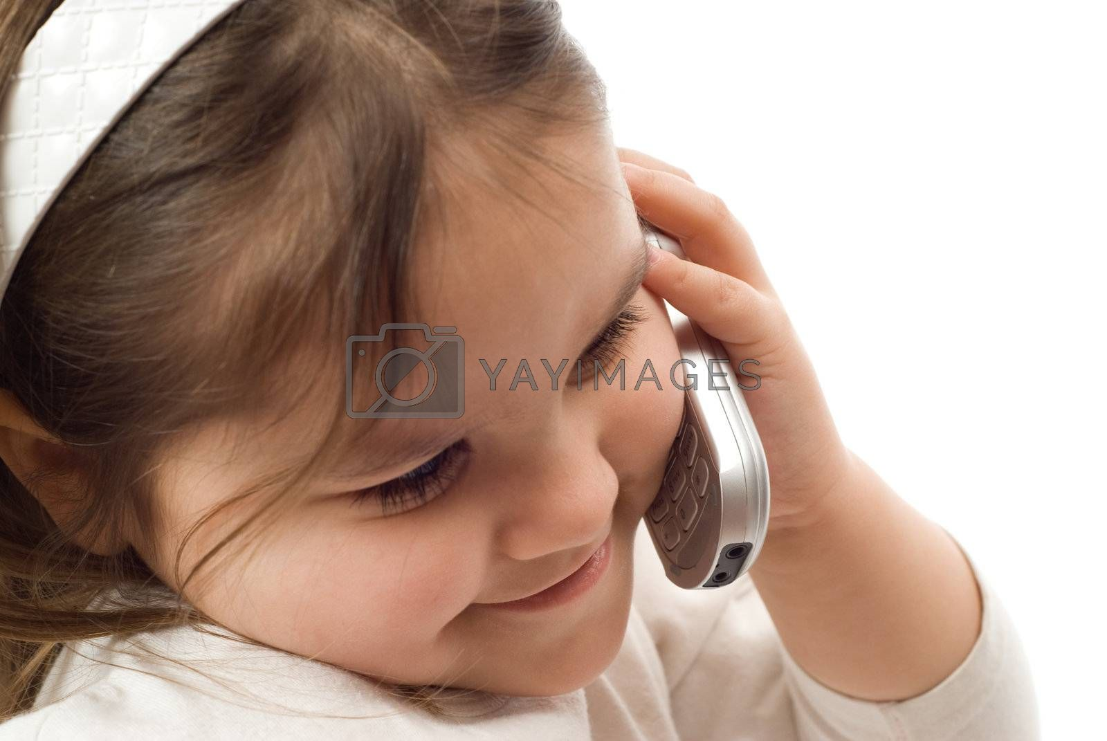 A young girl having a phone conversation on a cellphone
