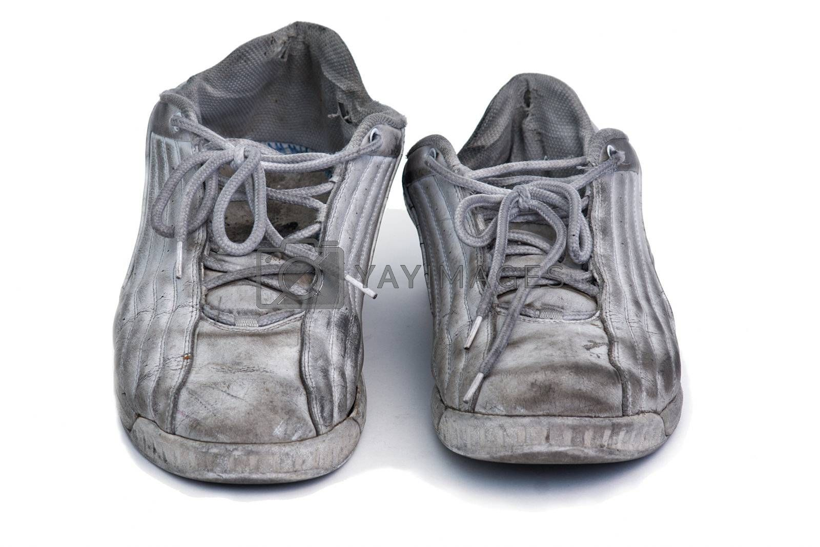 Royalty free image of worn sneakers by GunterNezhoda