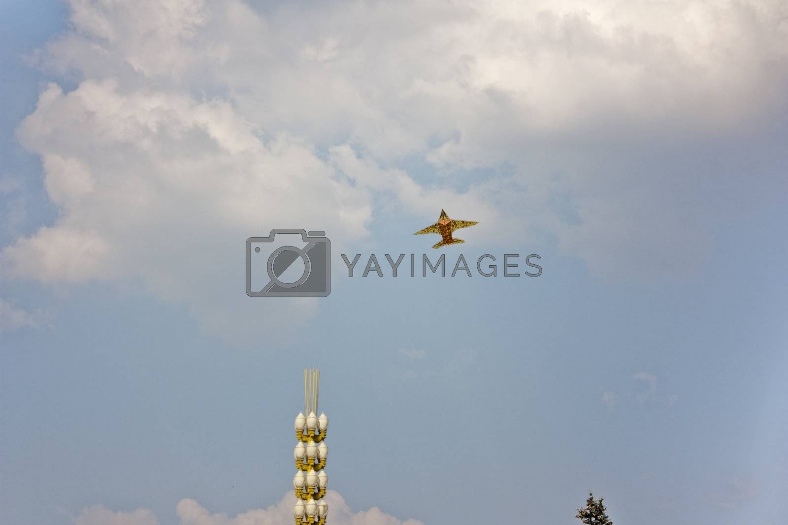 Royalty free image of Airplane above the clouds by Baltus