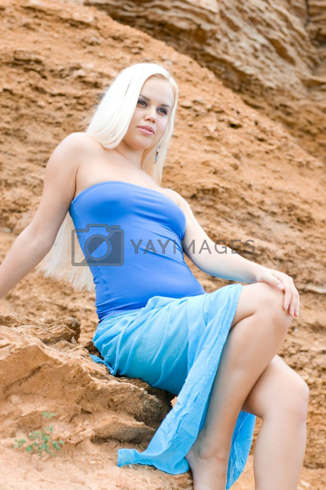 Royalty free image of attractive blond woman in blue by marylooo