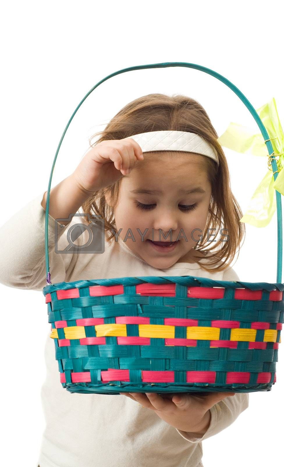 A young girl looking inside her Easter Basket, isolated against a white background