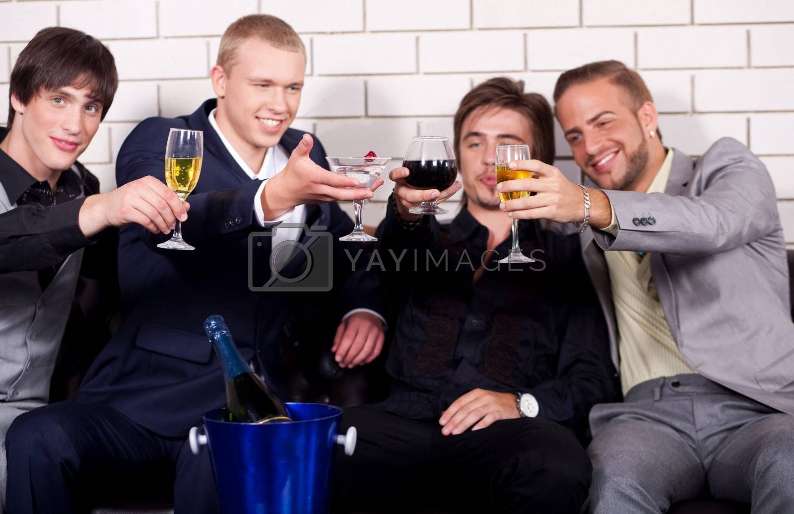Group of friends have fun and drink at night club