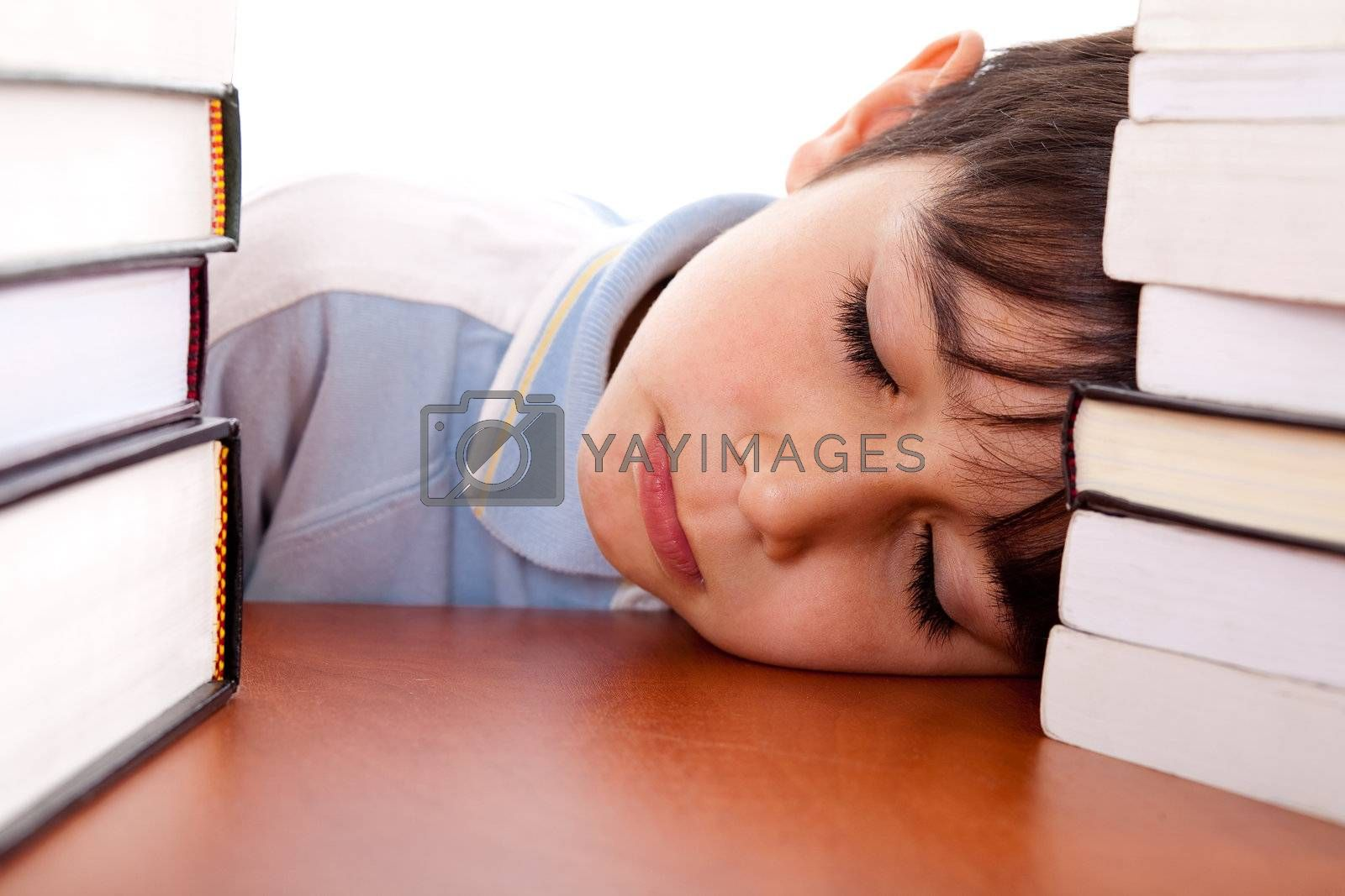 School boy tired of studying and sleeping on table