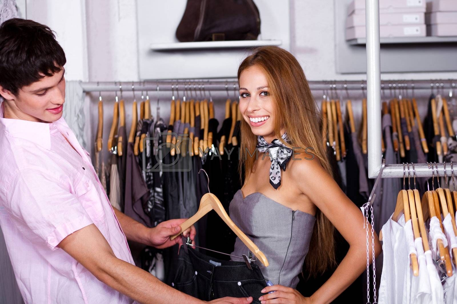 Couple trying outfits at retail shop