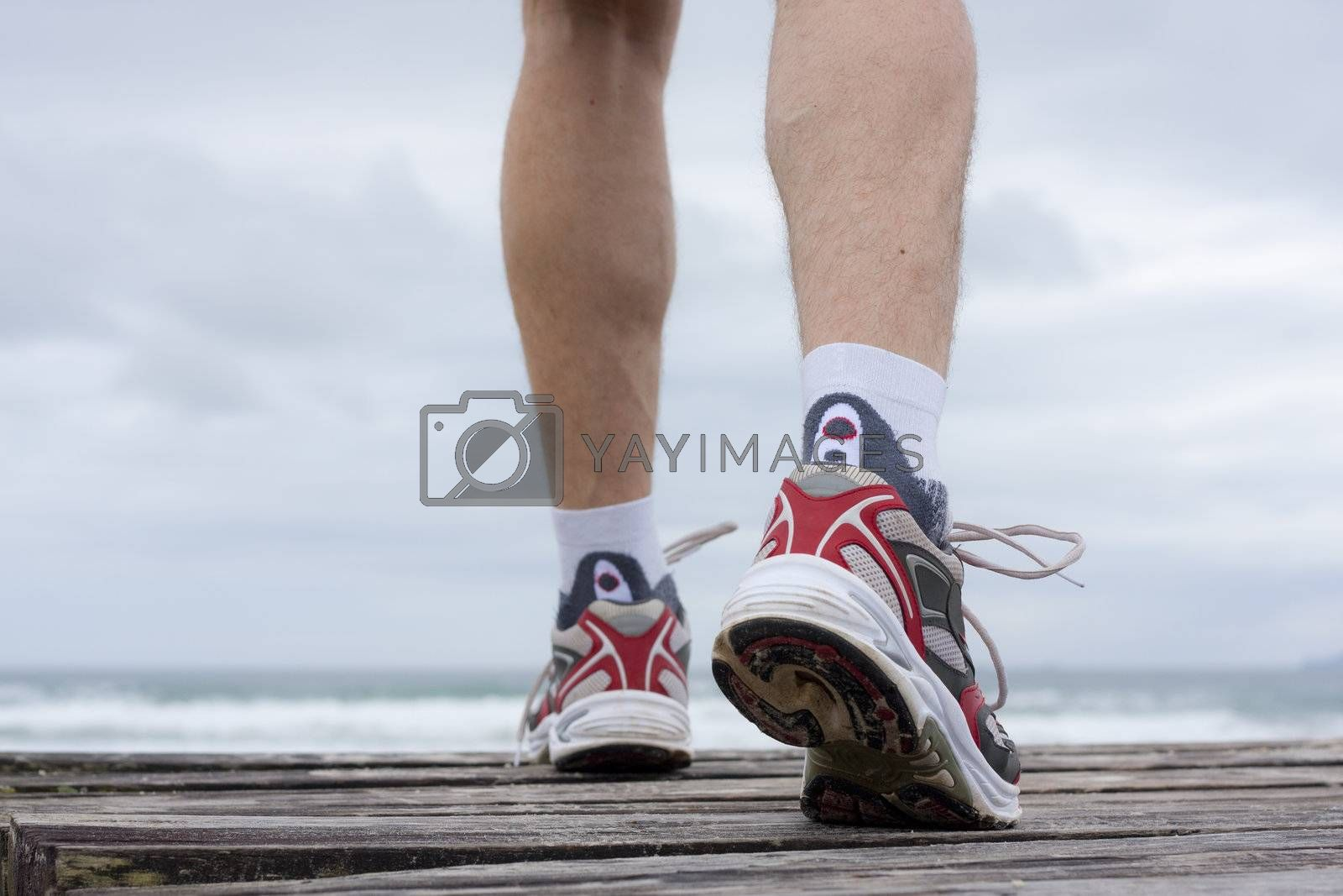 Royalty free image of Feet of runner on a beach by ArtmannWitte