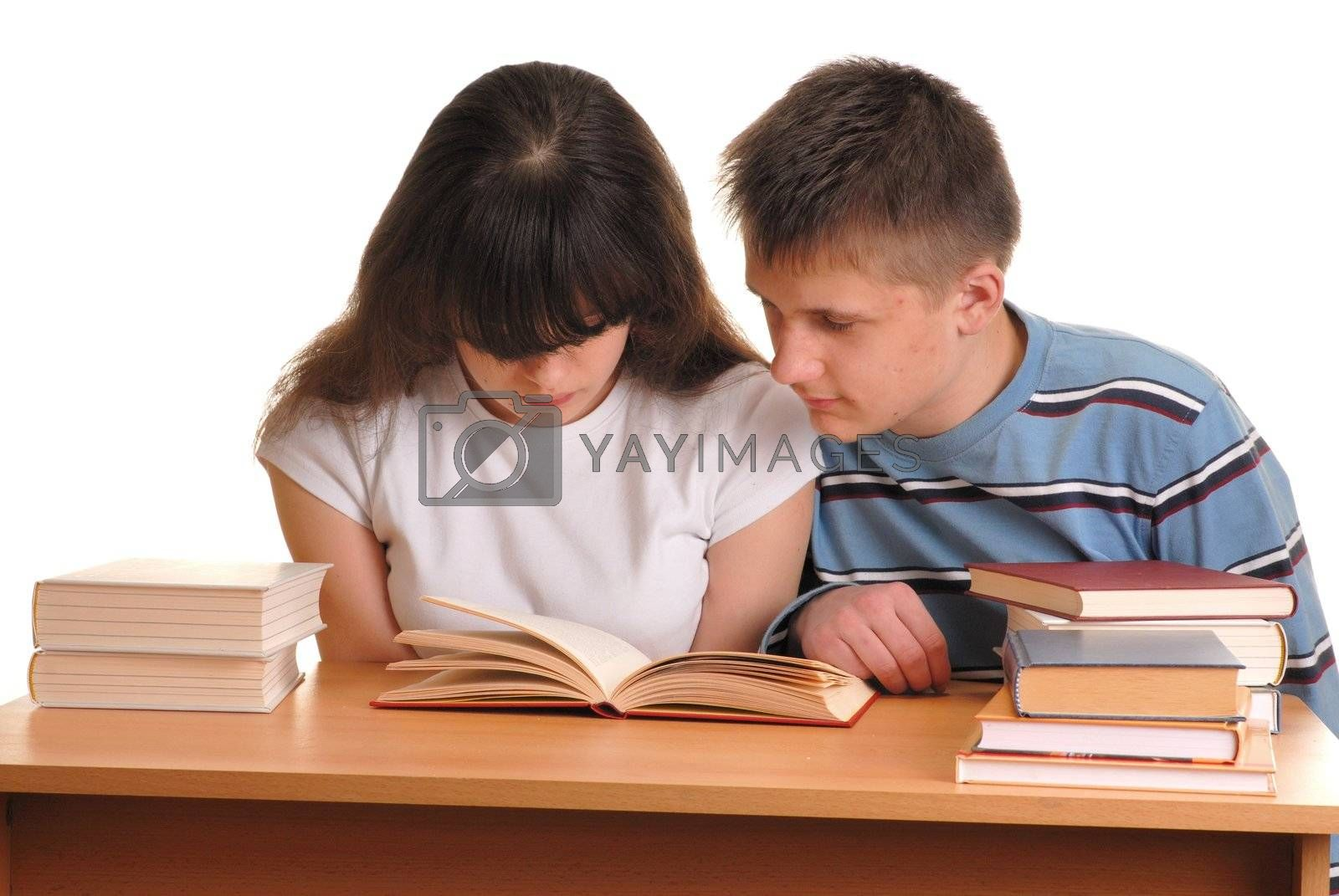 Teen sitting at desk and reading books