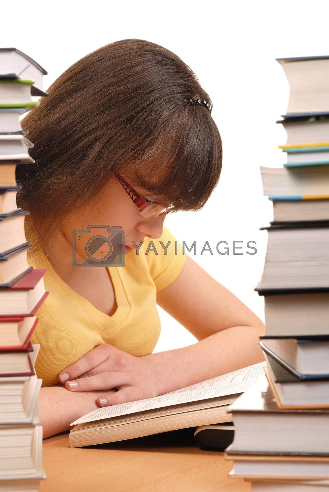 Teenage girl reading a book in a library
