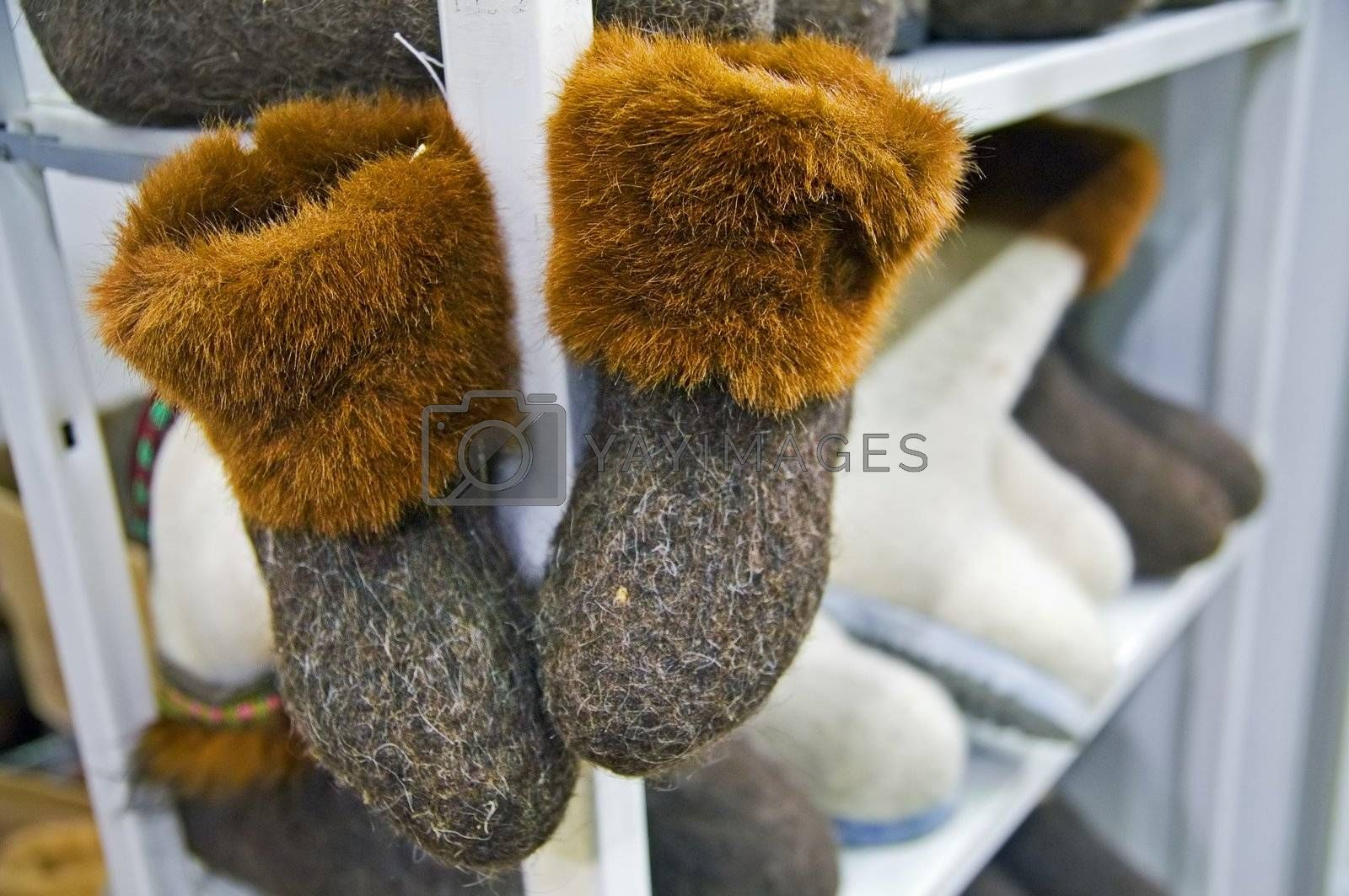 Traditional Russian felted shoes on shelf