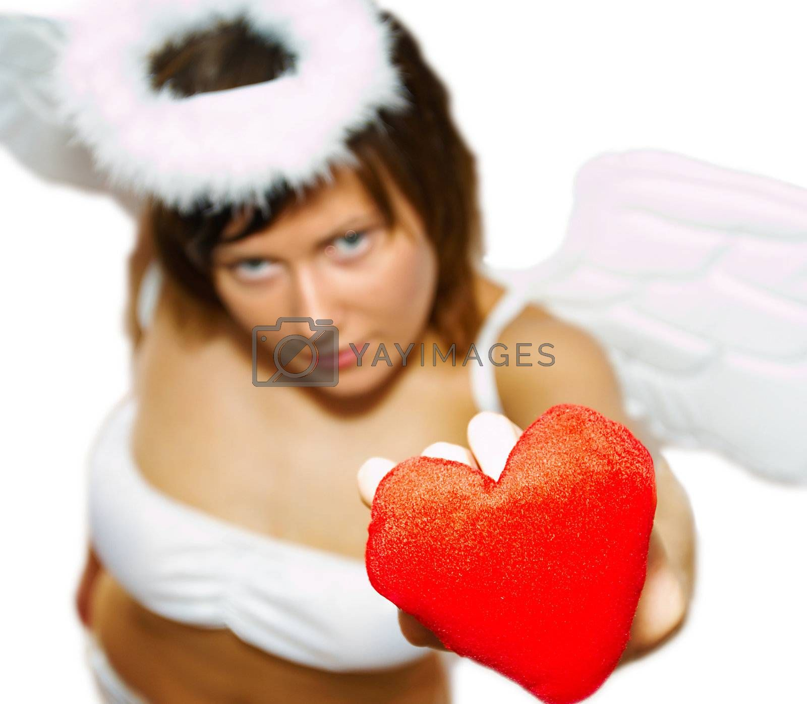 Young woman in angel's costume with red heart