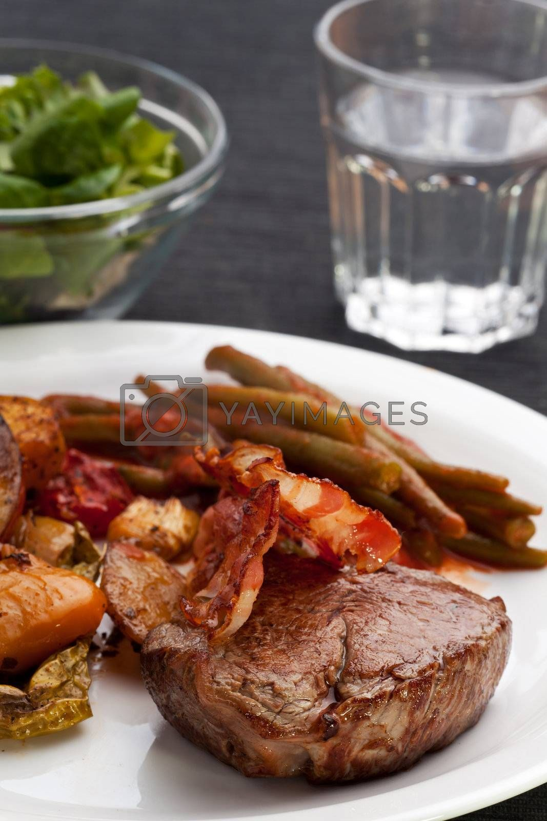 grilled steak with bacon stripes by bernjuer