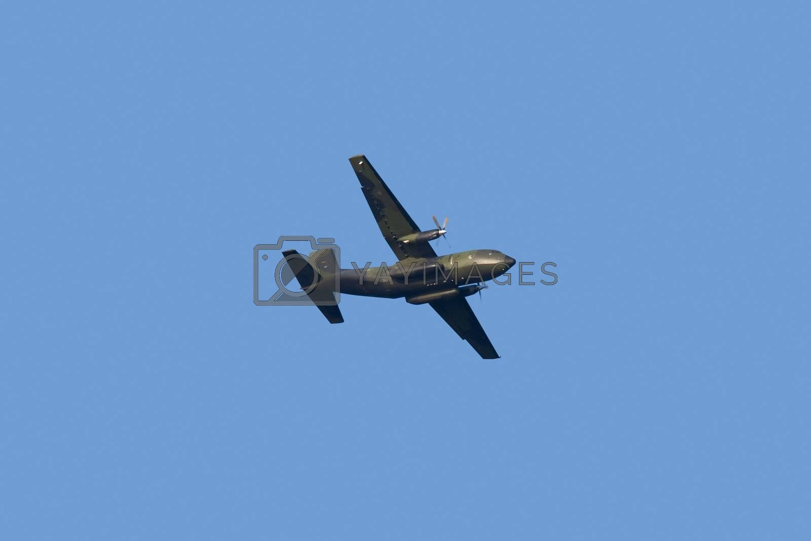 Military propeller aircraft flying in a clear skies