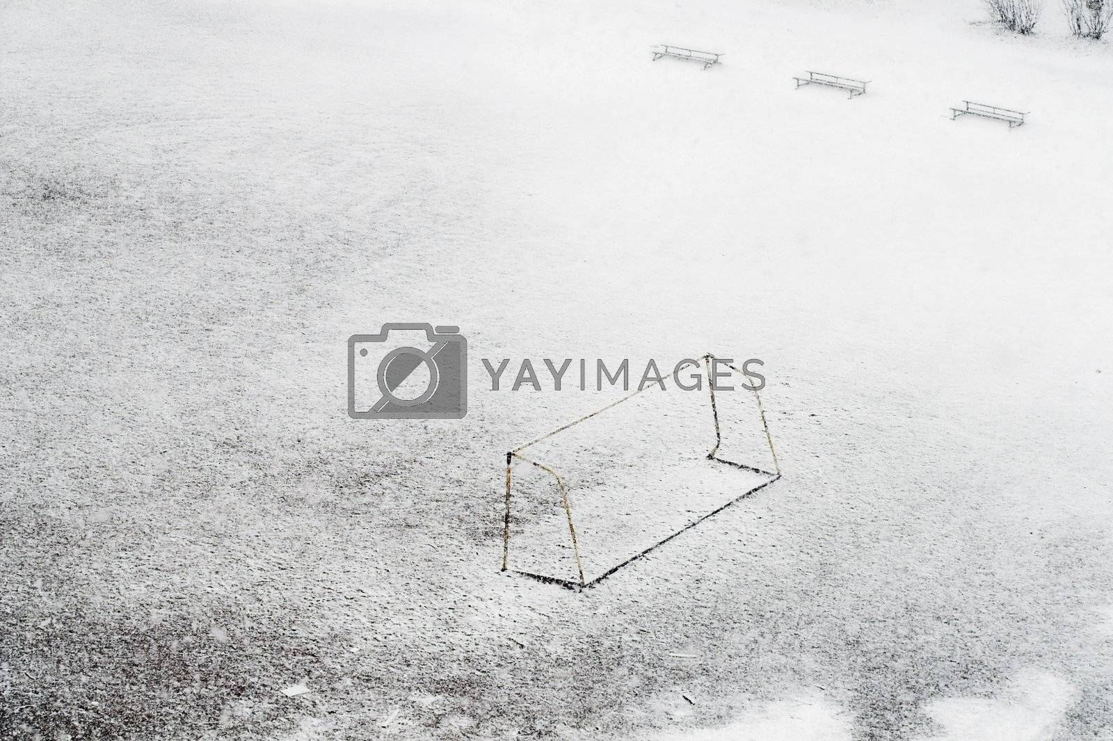 School football ground while snowfalling
