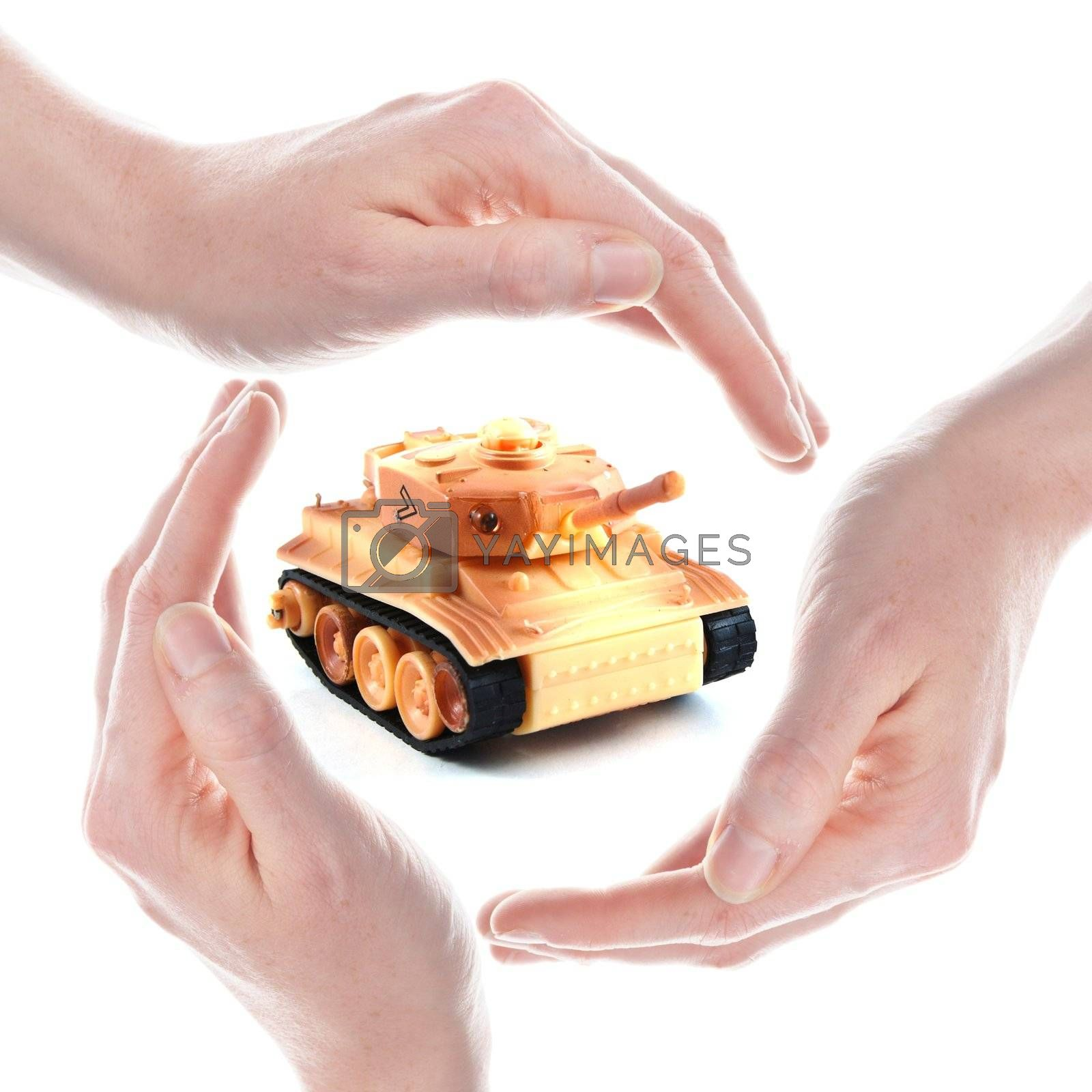 peace concept with toy tank and hand isolated on white background