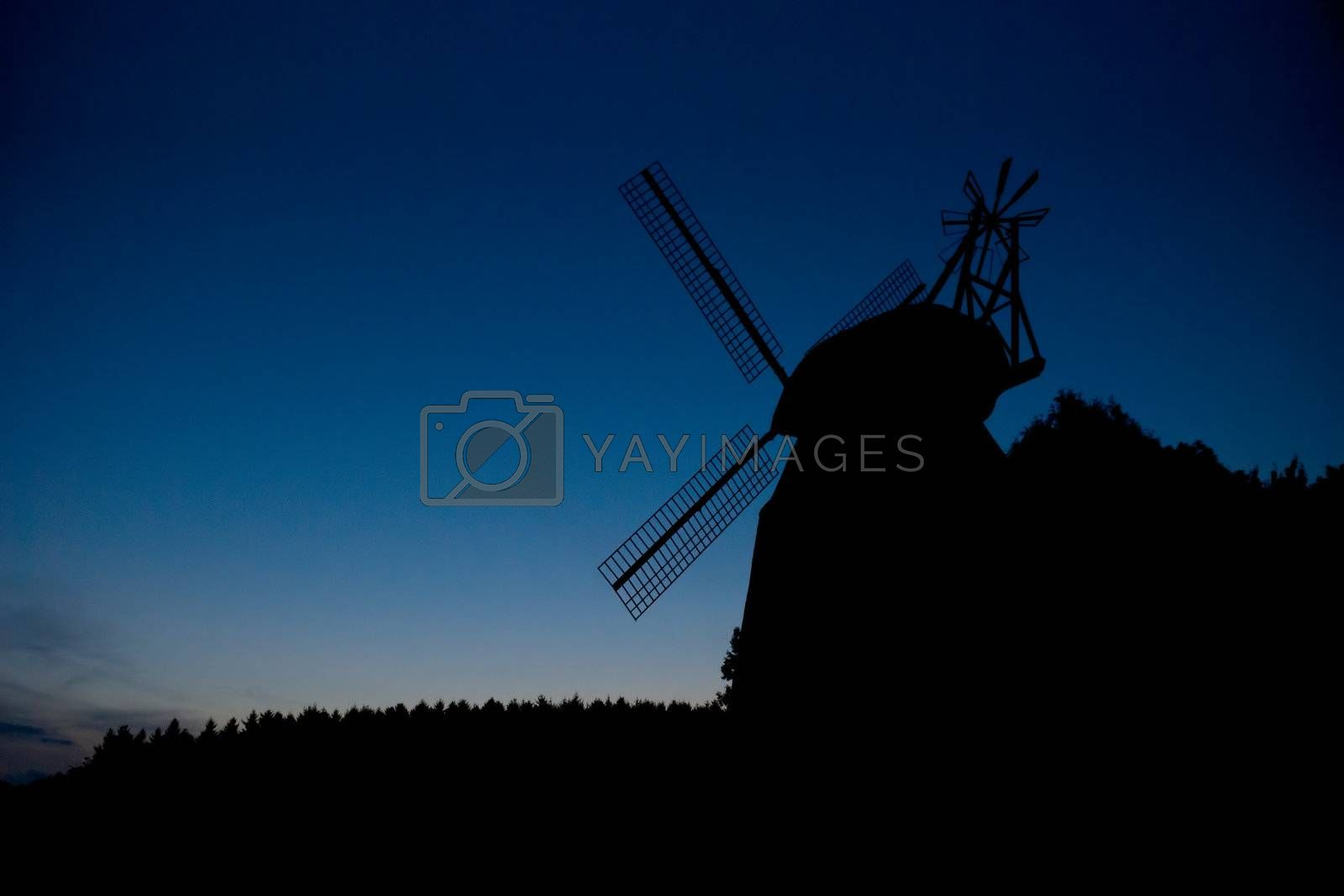 Silhouette of the windmill at dusk