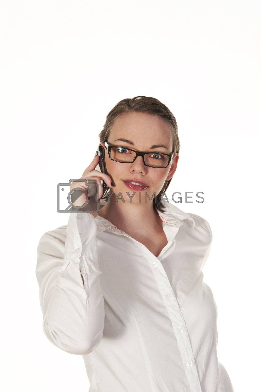 Beautiful girl answering a telephone call, seen isolated on white background