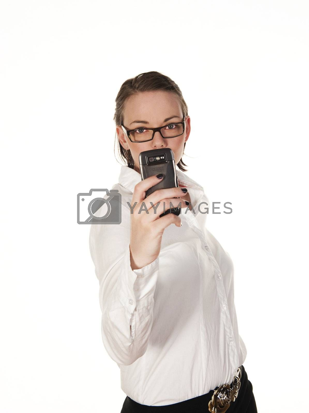 Beautiful girl text messaging, seen against white background