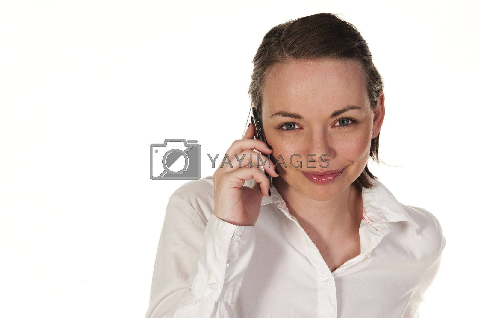 Beautiful girl speaking on the phone, seen against white background
