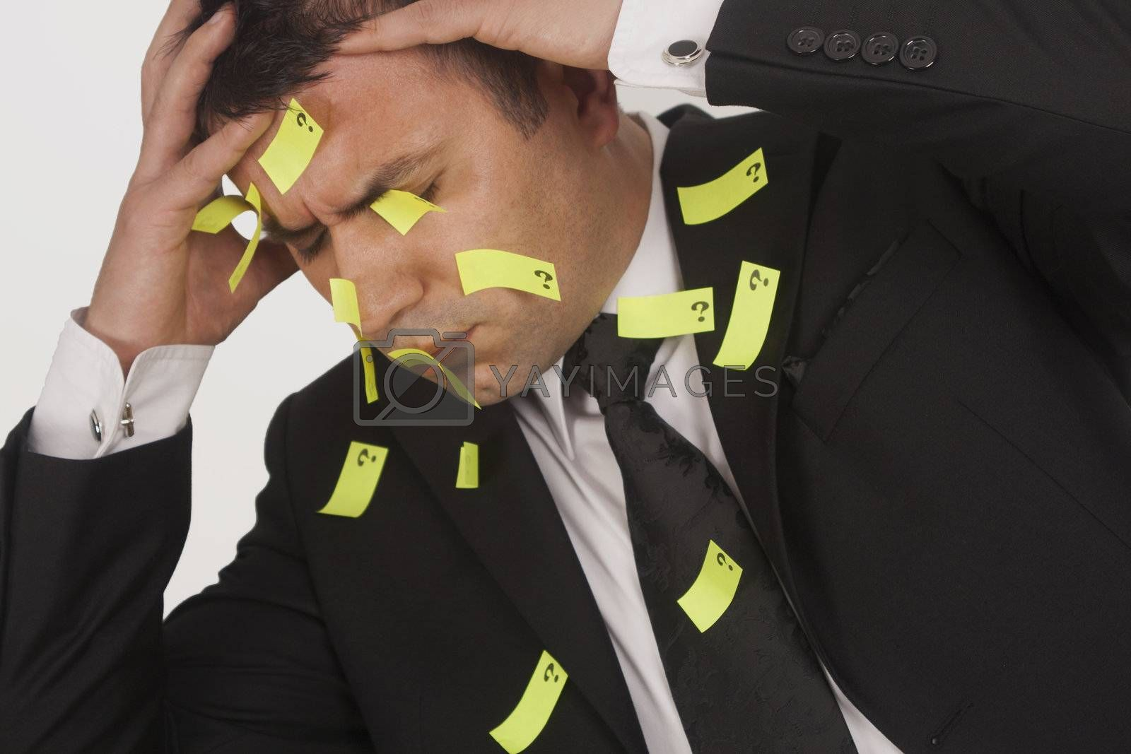 Man has sticky stickers on his suit. He looks very busy. White background.