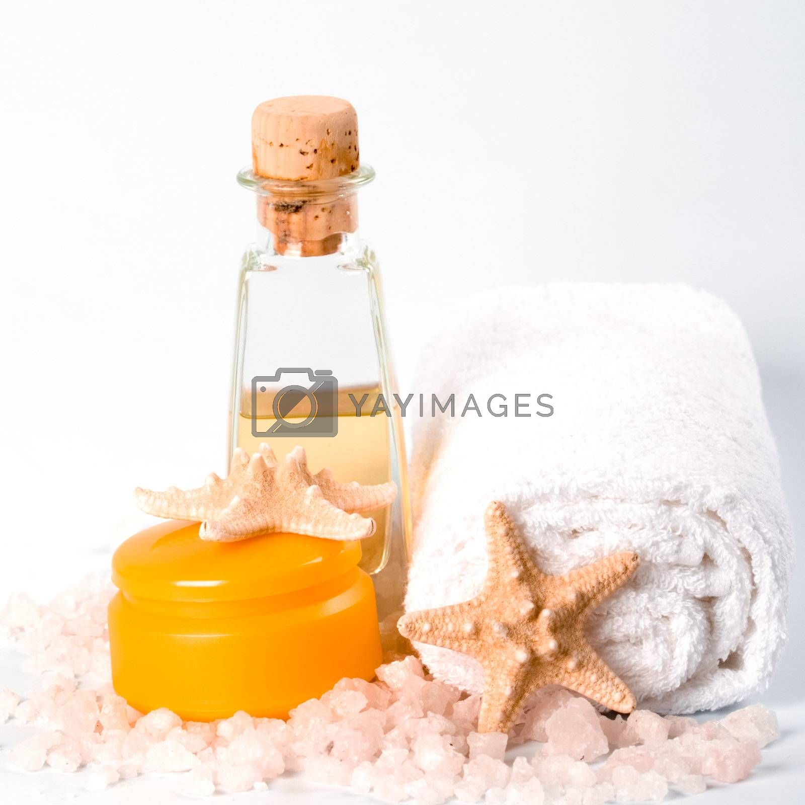 spa products: sea salt, towel, facial creme oil and stars