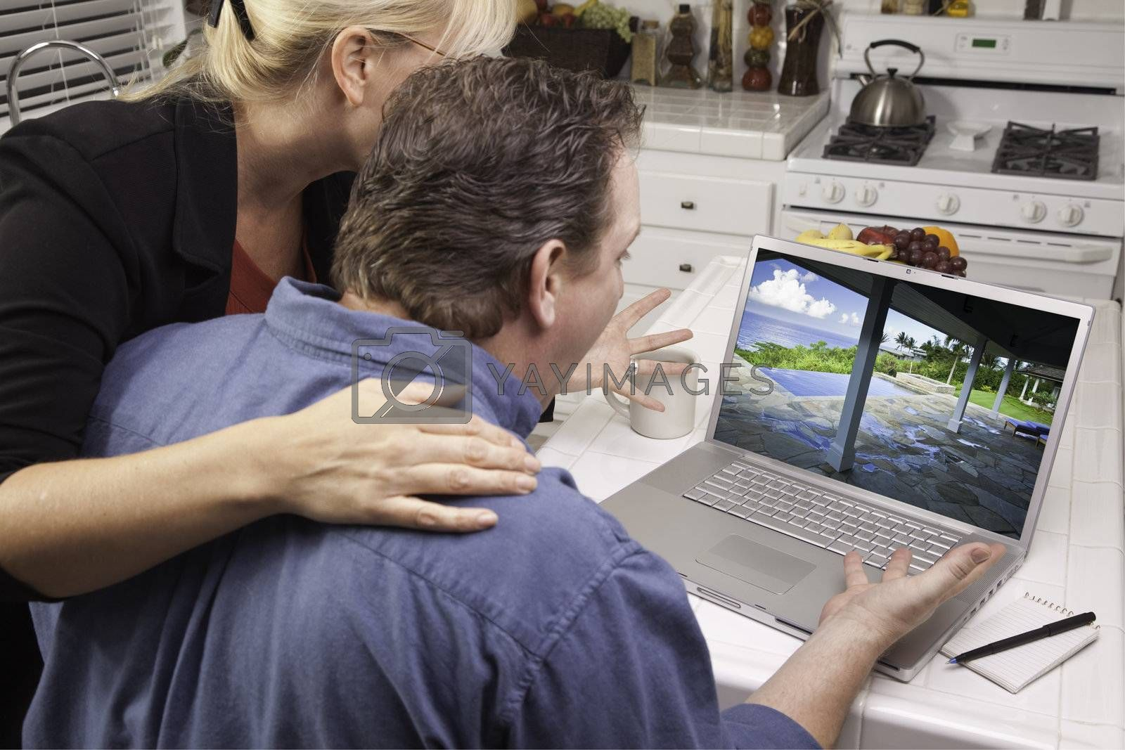 Couple In Kitchen Using Laptop to Research Travel and Vacations. Screen can be easily used for your own message or picture. Picture on screen is my copyright as well.