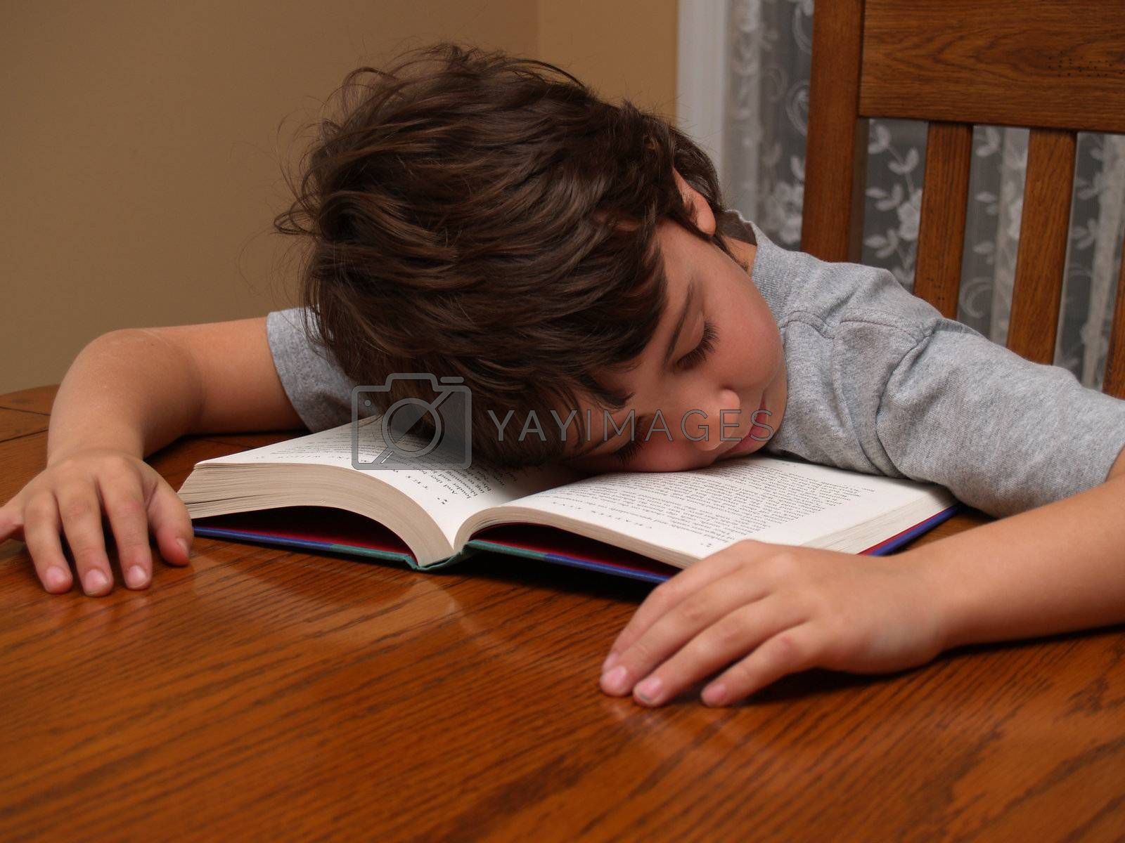 a young boy who fell asleep while reading a book