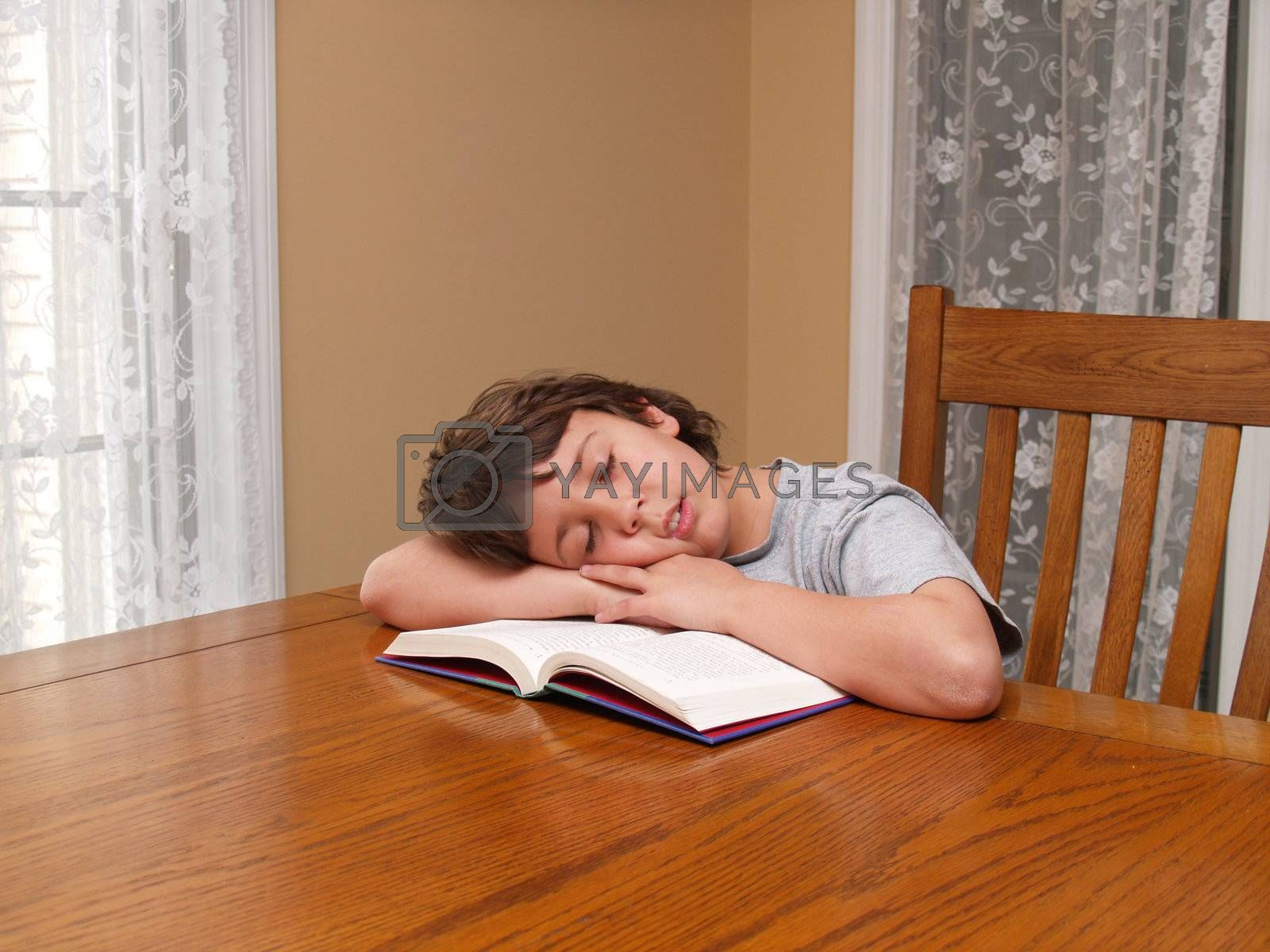 young boy who fell asleep while reading a book