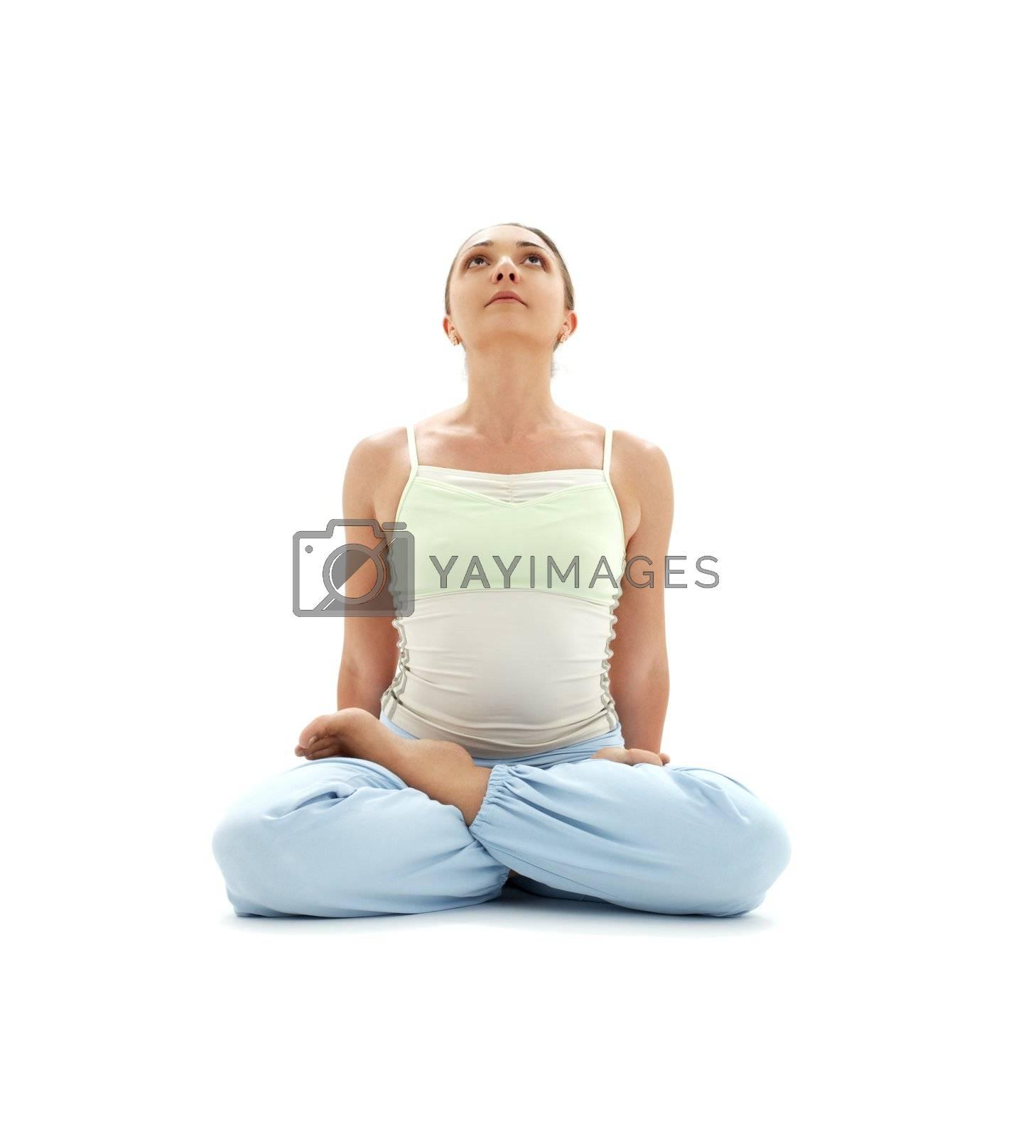 sporty girl practicing padmasana lotus pose over white