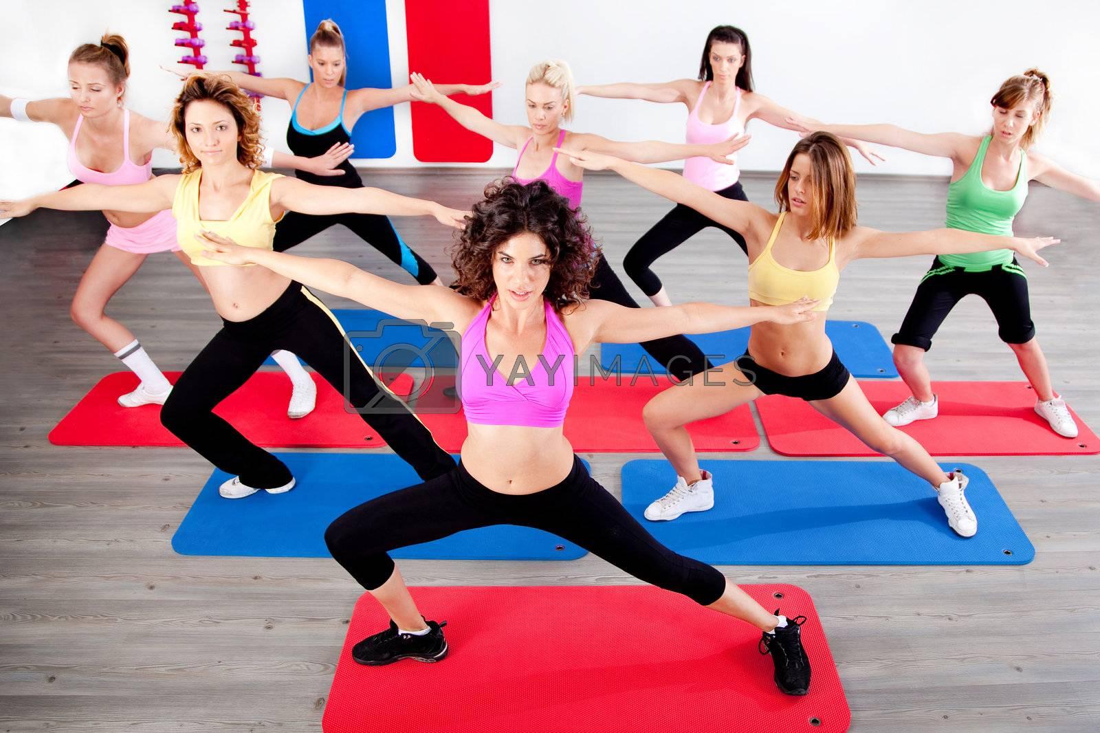 image of women doing streching in aerobic class