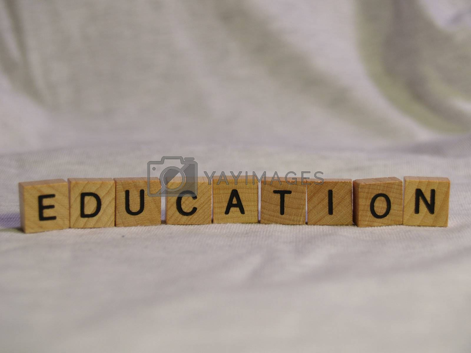 The word EDUCATION spelled out with wooden tiles