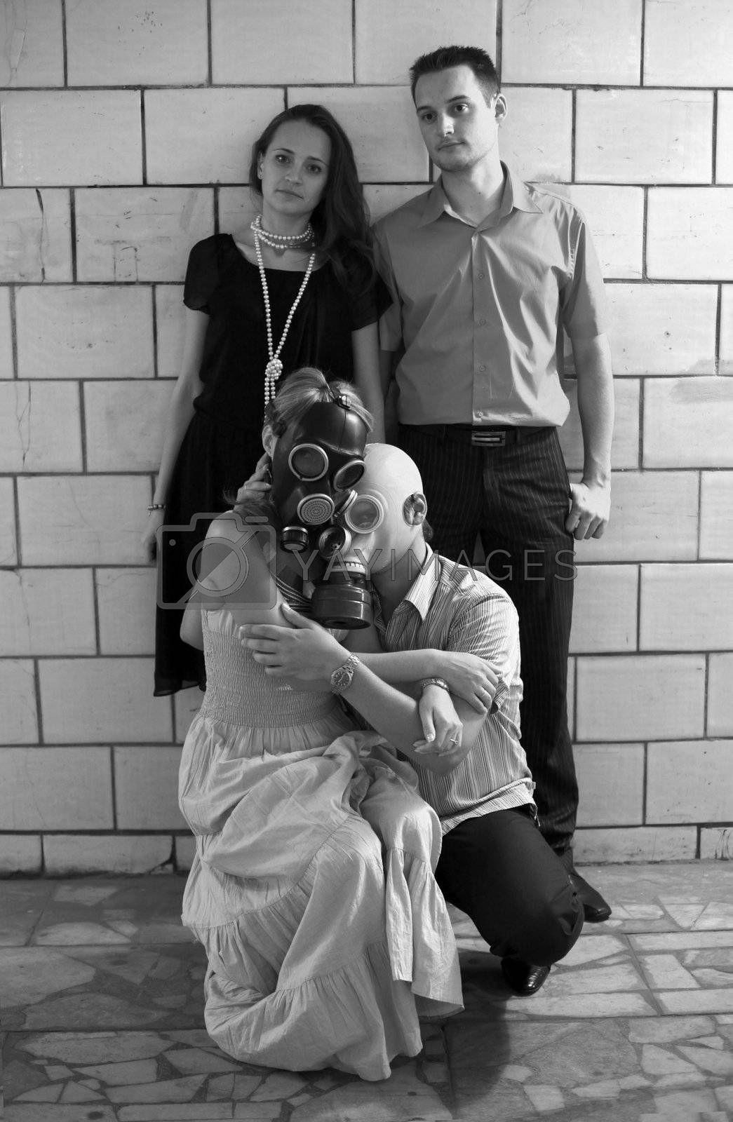 Two married couples in a tunnel, one of pairs in gas masks