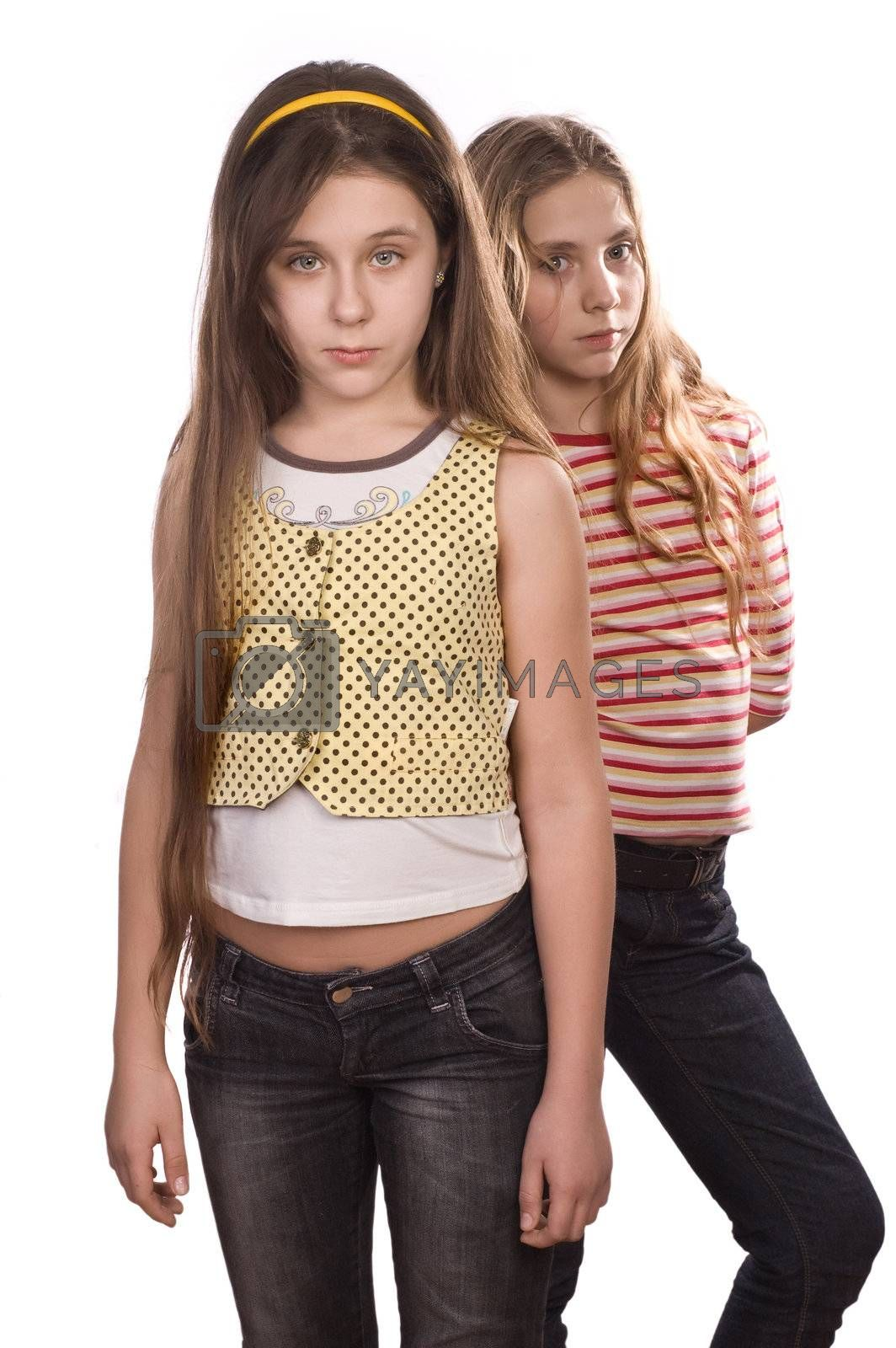 Royalty free image of Two teenage girls standing isolated on white by iribo