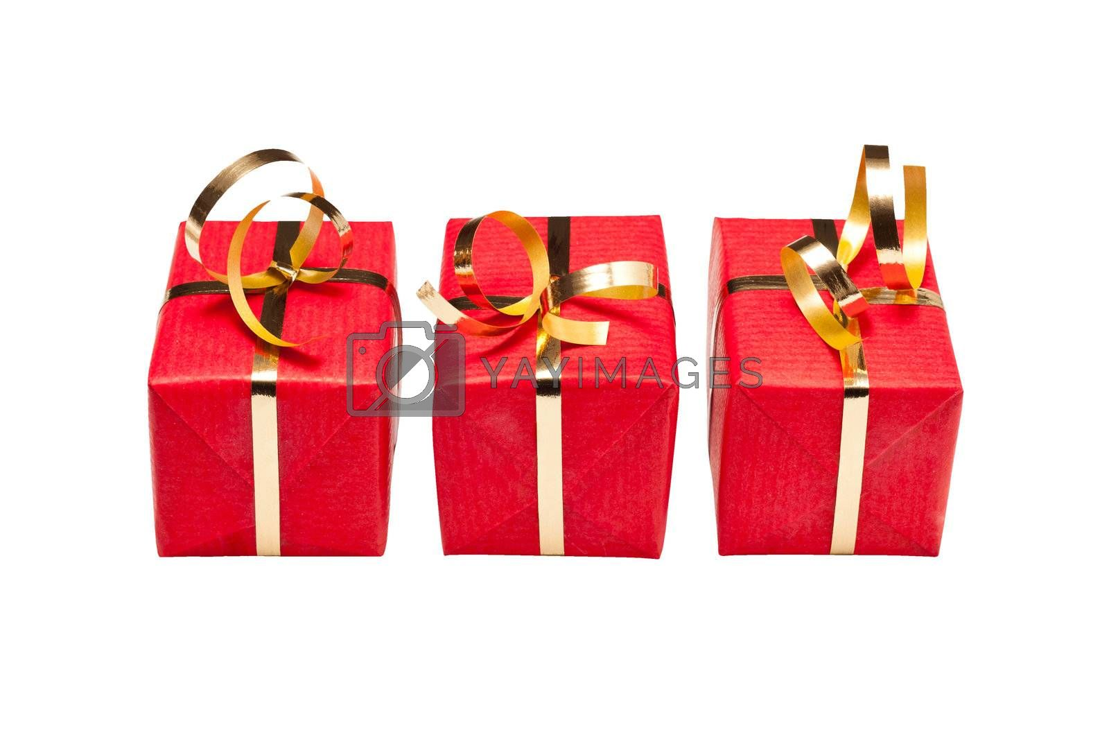 Royalty free image of Trio of Red and Gold Xmas Gift Boxes by timh