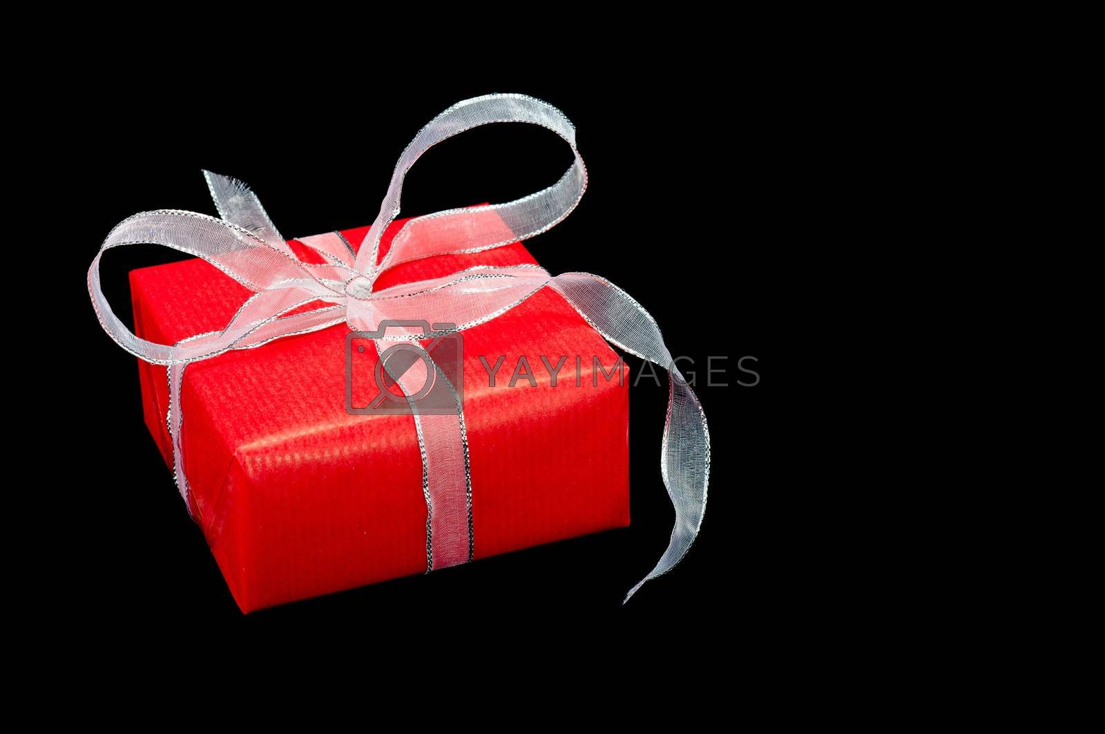 Royalty free image of Red and Silver Xmas Gift Box on Black by timh