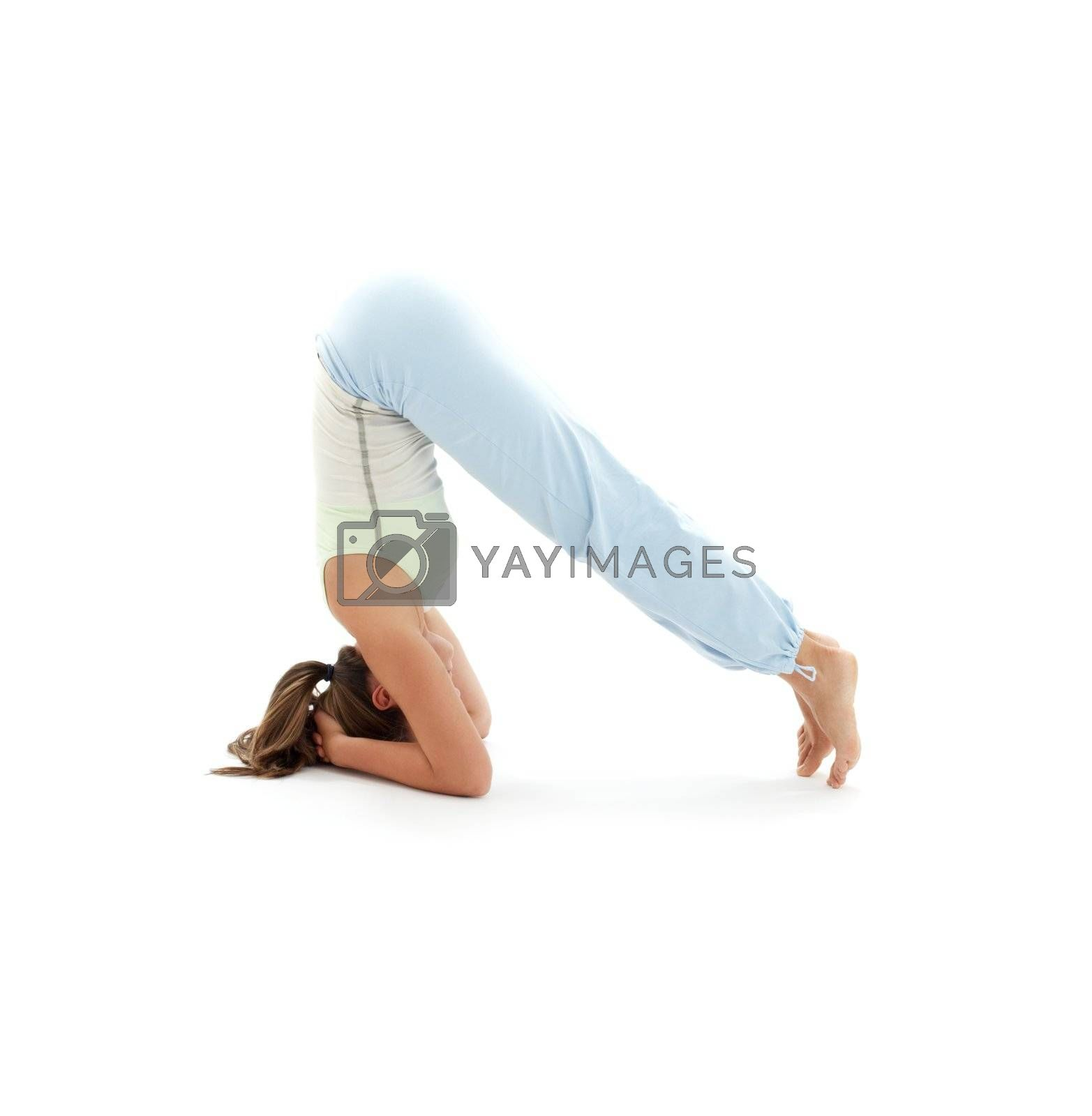 sporty girl practicing salamba sirsasana supported headstand