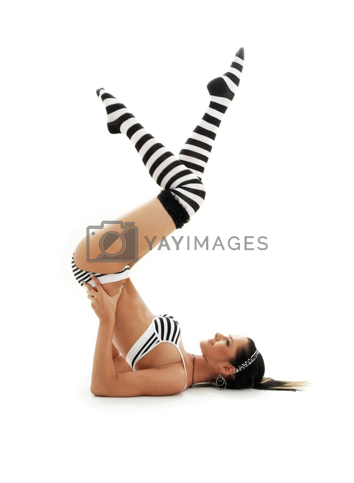 striped underwear girl practicing salamba sarvangasana supported shoulderstand